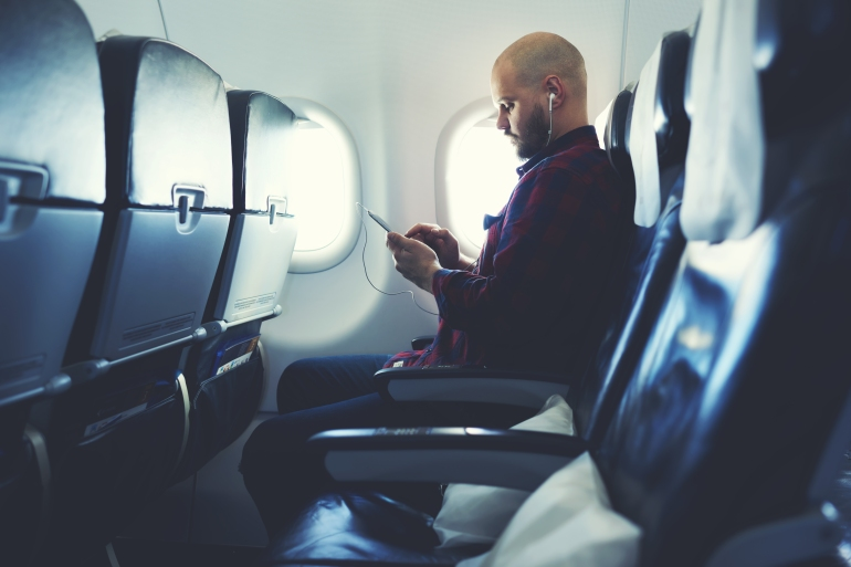 Boy using phone on airplane.jpg